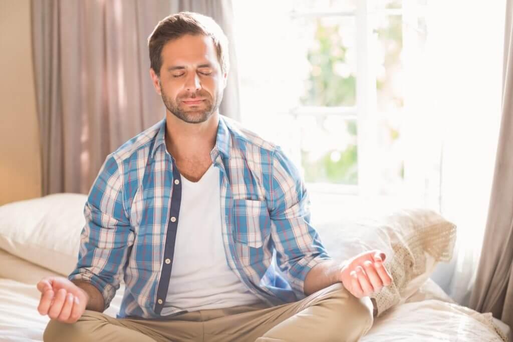 man meditation shirt plaid window san diego drug detox centers
