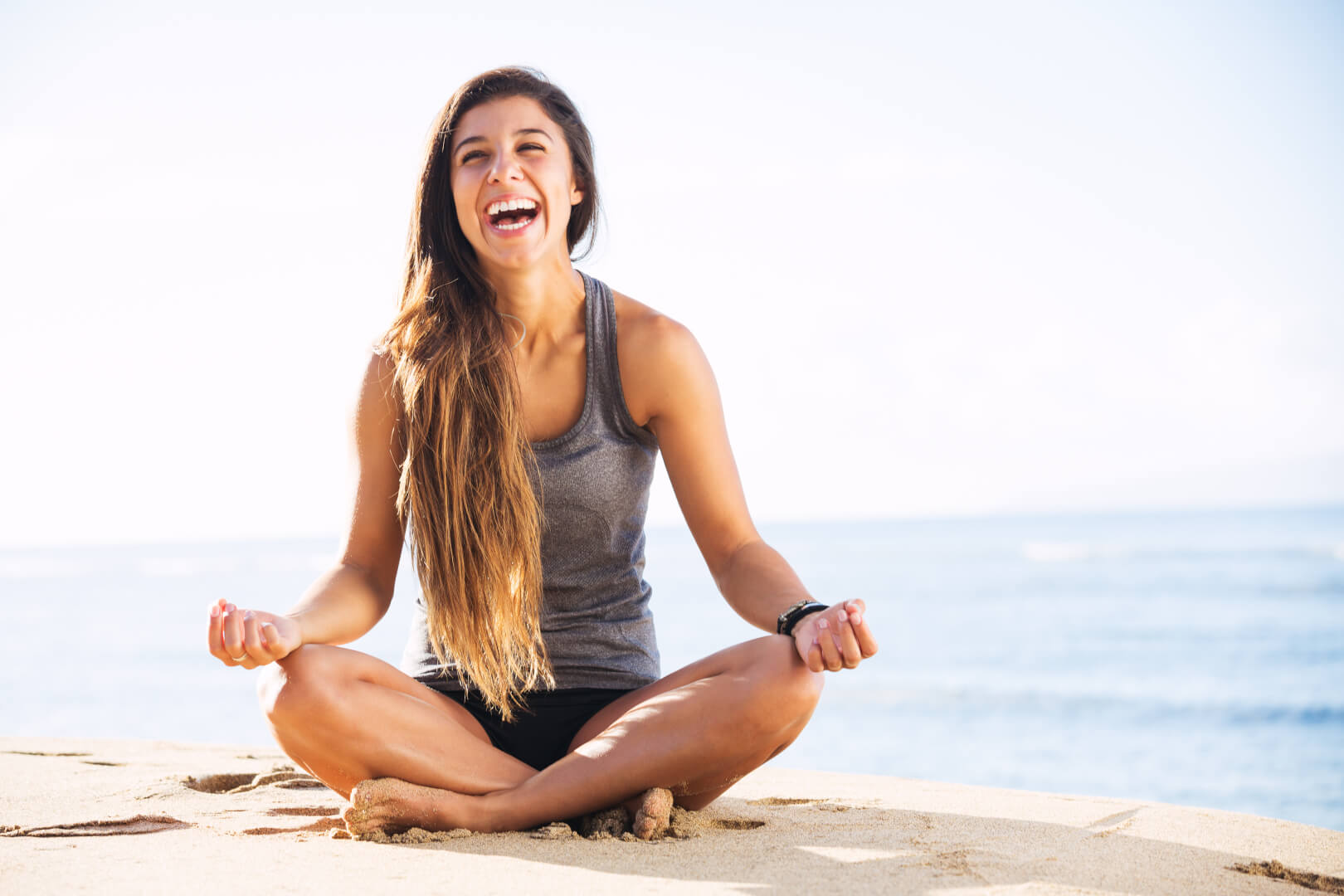 alcohol facilities san diego young female yoga pose smile laugh ocean