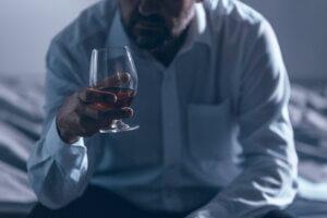 alcoholism treatment man holding wine glass alcoholic