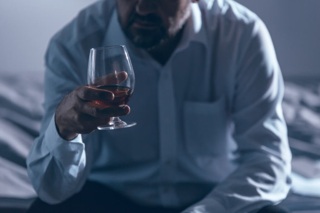 alcoholism treatment man holding wine glass alcoholic