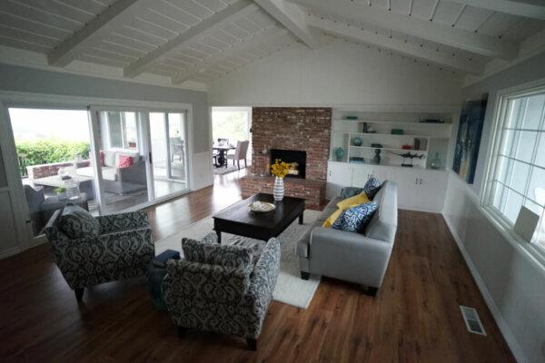 sofa living room detox and sober living san diego wooden floor vase flowers white wooden beam roof