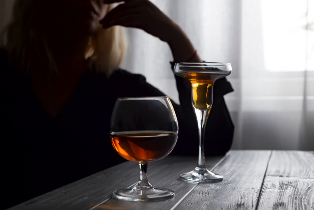 woman drinking alcohol alone