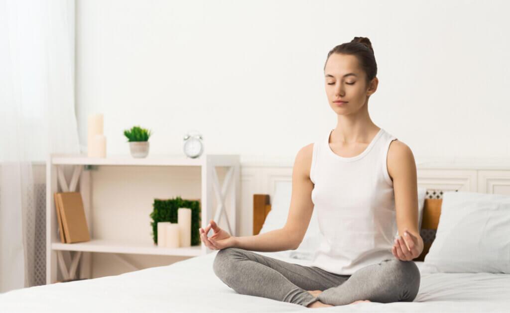 woman meditating and practicing yoga