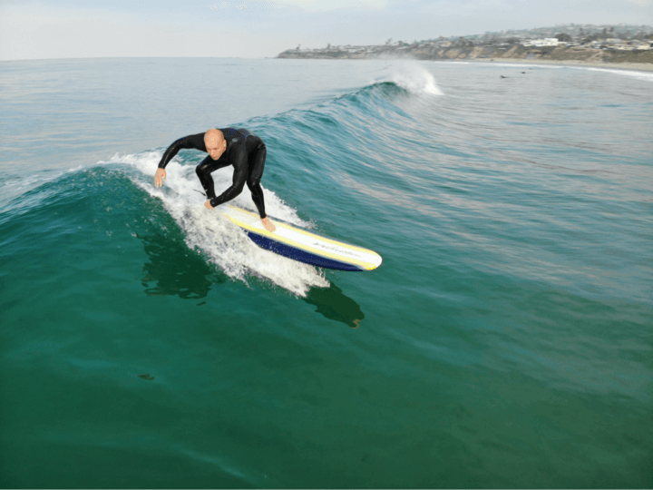 surfing wave san diego bald young man recovery program outpatient