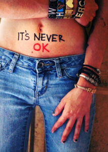 denim woman hand stomach body rape victim post traumatic stress disorder rehab