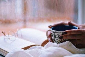 book and a cup of coffee or tea corona virus covid 19 self isolation quarantine self care me time