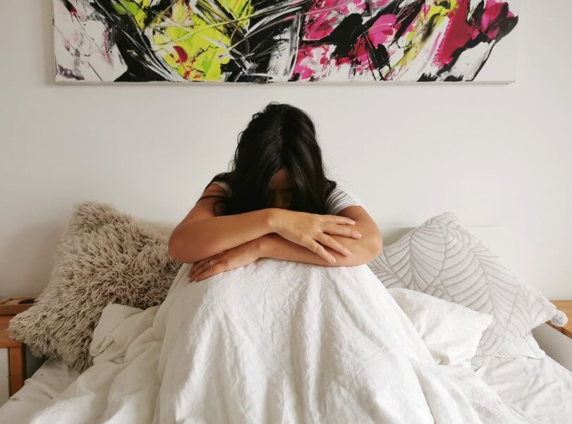 sad girl sitting in bed depression stress lonely klonopin rehab