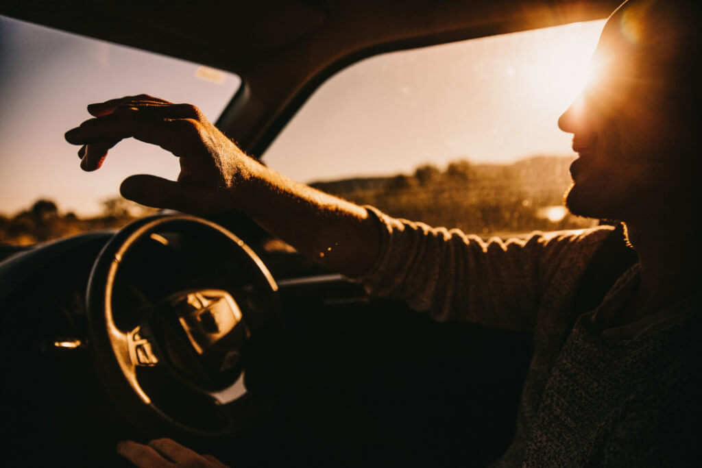 young happy male adult driving car schizophrenia