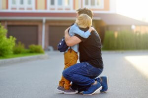 child boy bully parent comfort support school console together father bored embrace hug consolation