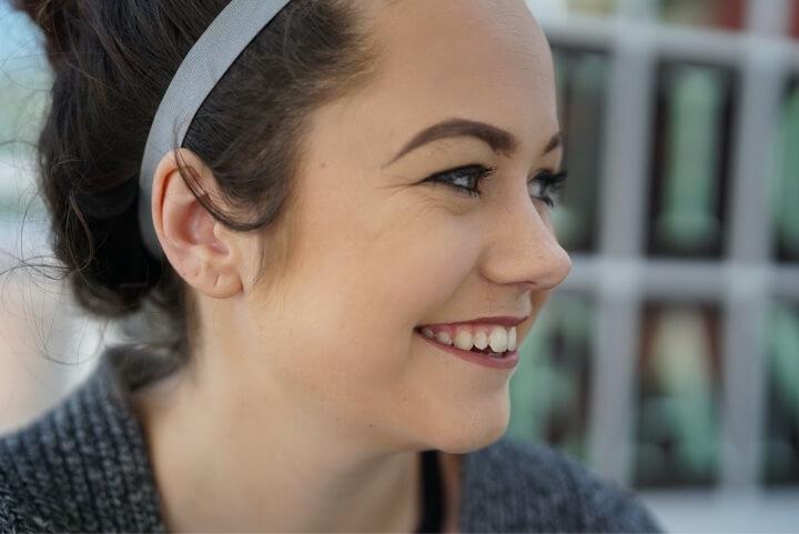smile brown hair woman grey sweater addiction california treatment