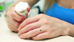woman pouring bunch-of prescription fentanyl opiate pills into hand rehabilitation heroin rehab
