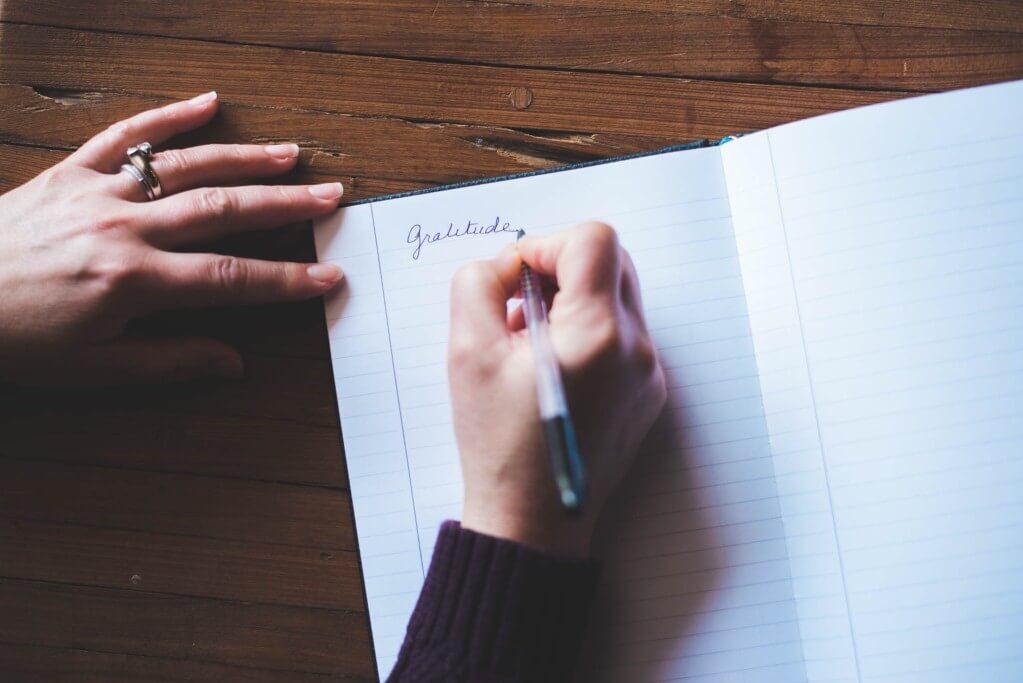 gratitude journal health wellbeing wellness hand writing pen