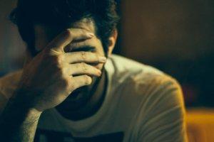 sick and tired klonopin abuse treatment man hand dark hair