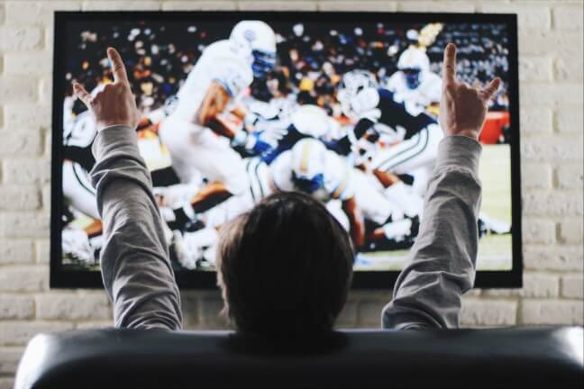 the man watches on sports the channel on tv tom brady hands up aging footbal sanders american president