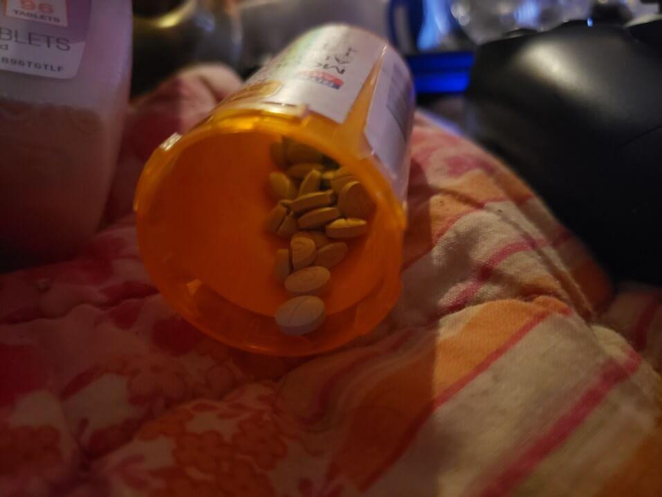 xanax abuse rehab pills bottle orange spilled bed pharma blanket