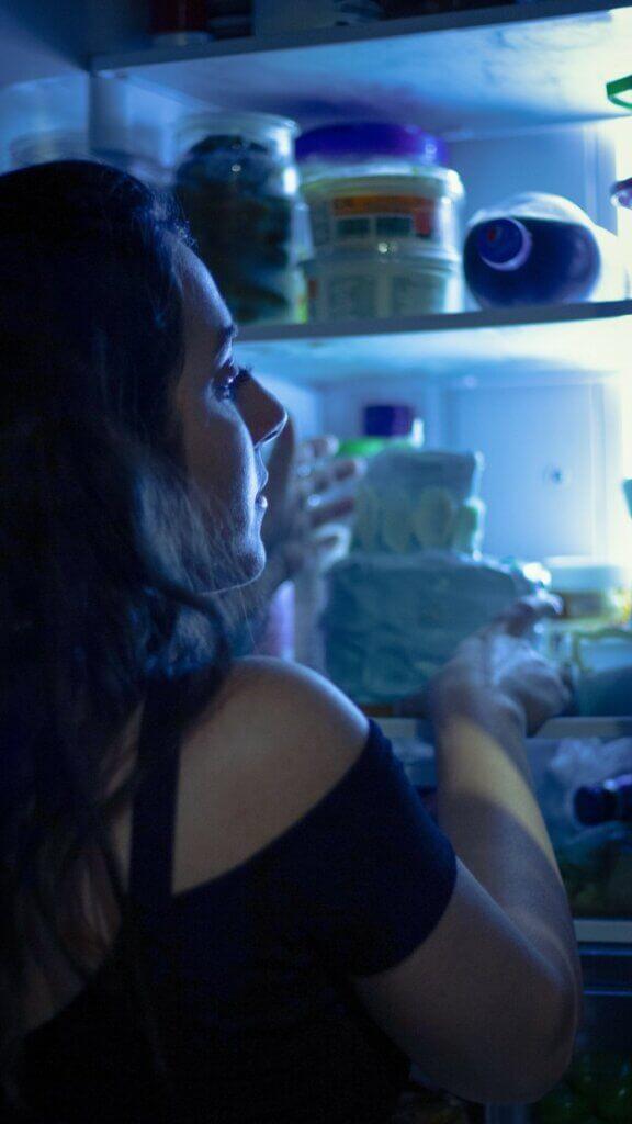 eating disorders woman taking food from the fridge at night adult nighttime night refrigerator fridge food