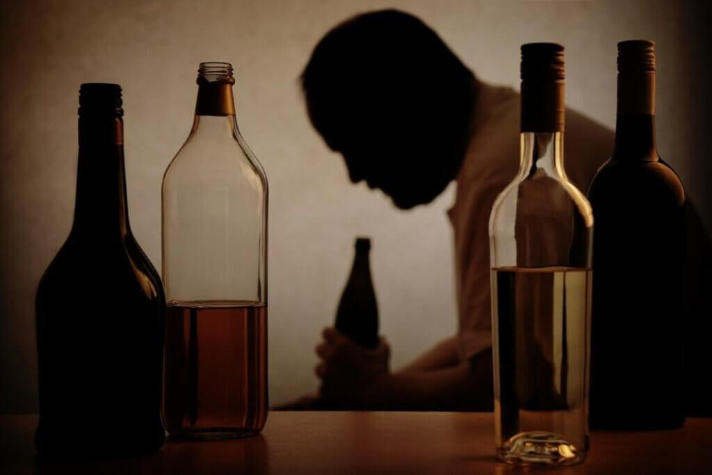 people drink alcohol bottle addiction drinking hitting rock bottom rehabilitation centre