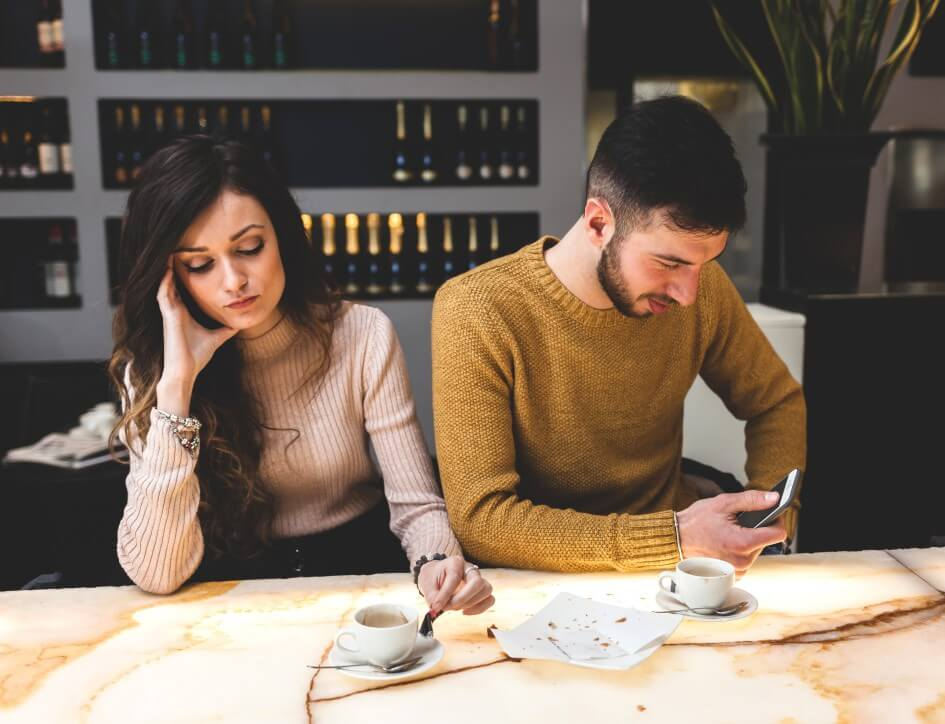relationship problems forgiving each other young beautiful couple at the bar drinking coffee concept of problems of love