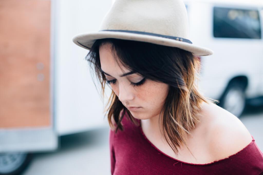 woman hat languor sad down anguish car hair