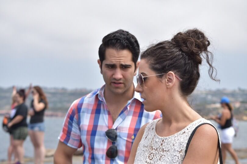 couple having a disagreement over alcohol drugs addict sea
